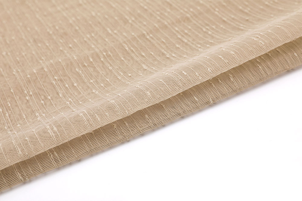 Inherently flame retardant voile curtain fabric