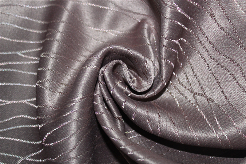Flame resistant embossed blackout curtain fabric